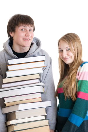 Young pair students with a pile of books isolated on a white background Stock Photo - 2747019