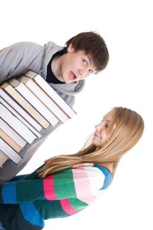 Young pair students with a pile of books isolated on a white background Stock Photo - 2746996