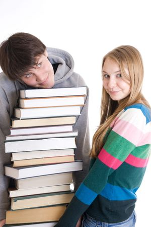 Young pair students with a pile of books isolated on a white background Stock Photo - 2747022