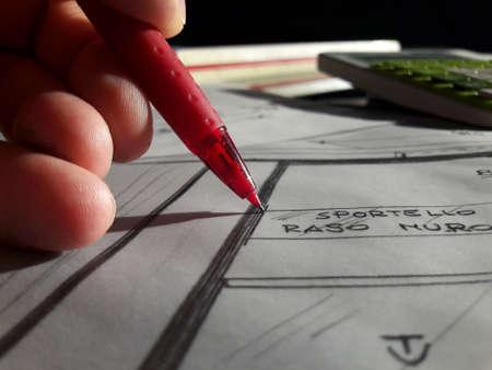 Architect designing freehand with his pencil 版權商用圖片
