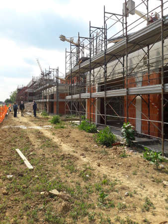 Work in progress on the construction site in the summer - build Zdjęcie Seryjne