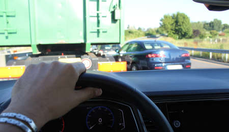 Driving the car on the highway in summer in traffic - tourism or business Stock fotó