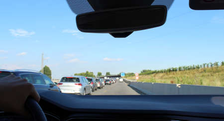 Driving the car on the highway in summer - tourism or business