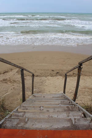 Wooden staircase to access the sea - summer holidays