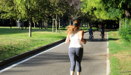 Young girl jogging at the park in September - sport