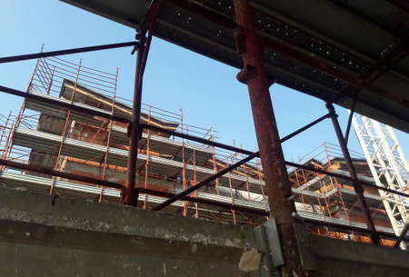 Work in progress on the construction site - crane and scaffolding