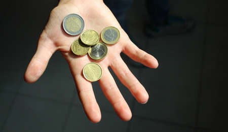 Euro coins in the hands of a boy