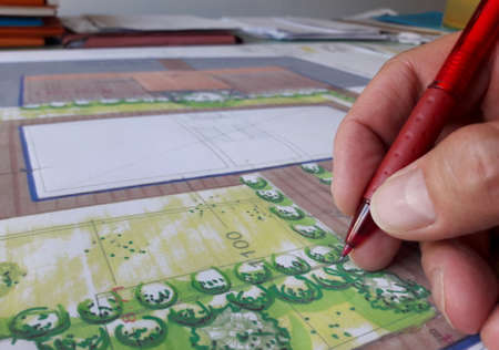 Architect who designs freehand in his professional studio