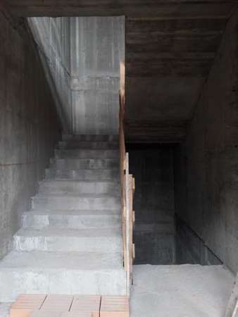 Work in progress on the construction site to create a reinforced concrete staircase