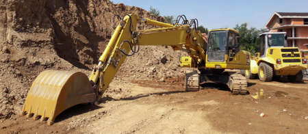 Bulldozer on the construction site in spring