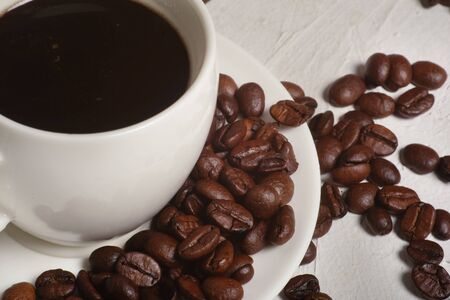 Coffee Cup and Beans on ferroconcrete white Table Stok Fotoğraf