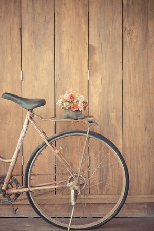 vintage bicycle on wooden house wall photo