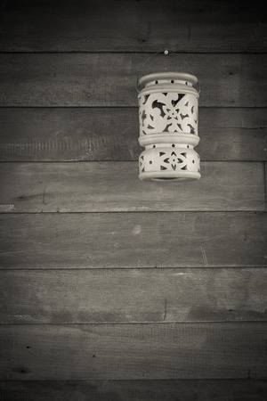plasticity: The plasticity of clay lamps hanging on old wooden wall. Stock Photo