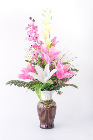 Bouquet of flowers in a vase on a white background. photo