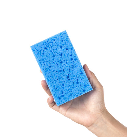 Woman hand holding a cleaning sponge isolated on a white background photo