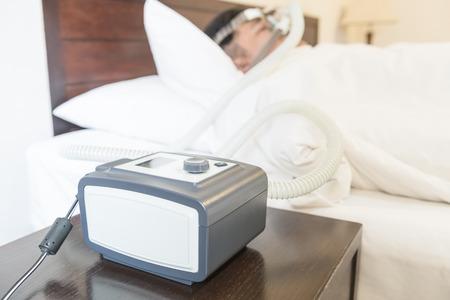 Man with sleep apnea and CPAP machine