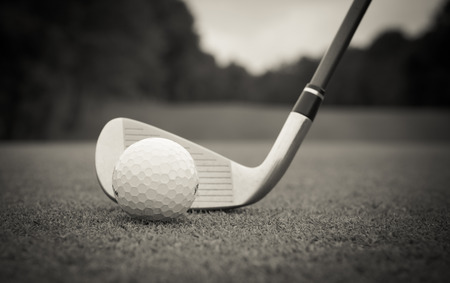 golf clubs: Golf ball was hit down the fairway toward on light of the sun. Stock Photo