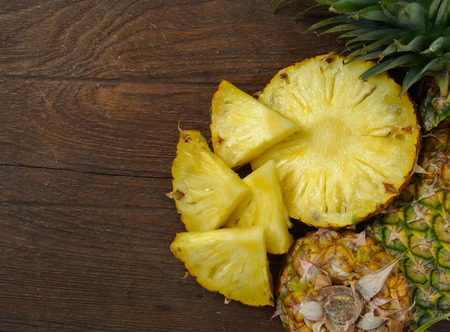 Pineapple on wooden background