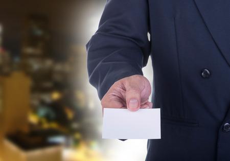 persuade: Businessman offer  business card to persuade investors