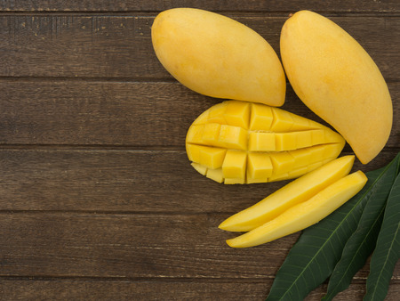 mango leaf: Fresh mango put on the wood table Stock Photo