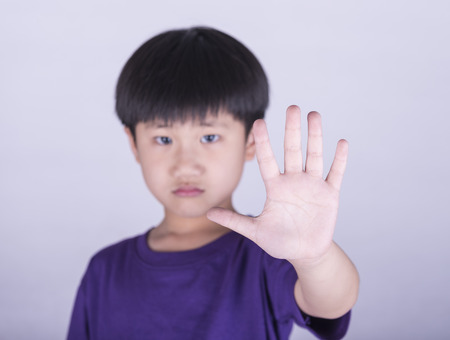 boy showing him denial with NO on him hand Stock Photo