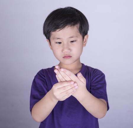 Boy with sore hands and fingers. Stock Photo