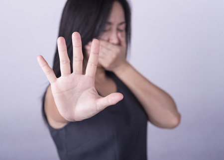 woman showing her denial with NO on her hand