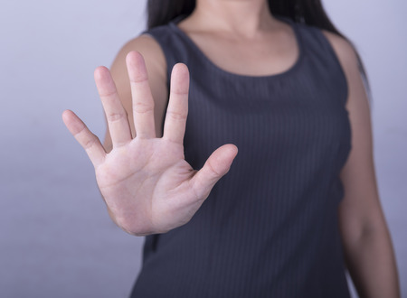 denial: woman showing her denial with NO on her hand