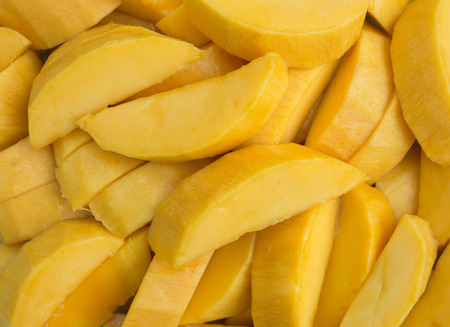 mango slice: Mango slice on a plate.