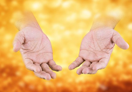 scrooge: Hand with gold behind, the concept of greed would have.(Negative human emotion) Stock Photo