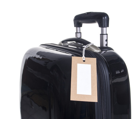 travel locations: Luggage tag with a black suitcase on a white background.