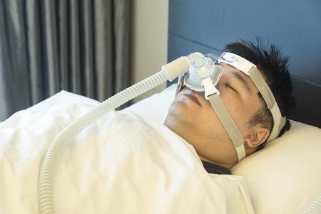 sleep mask: Man with sleeping apnea and CPAP machine