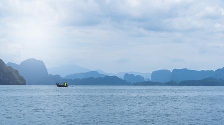 long tailed boat: long-tailed boat moored at sea