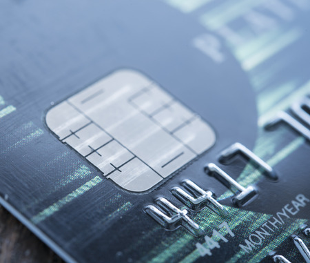 blue tone: close-up credit card. blue tone
