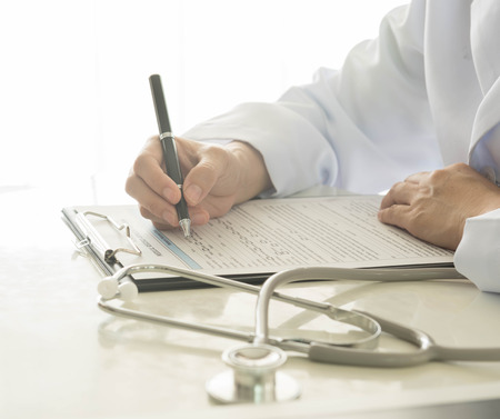 hospital notes: close-up of doctor taking notes on hospital