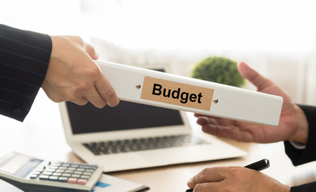 budgets: Accountant sends file budgets of the Company to executives. Stock Photo