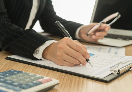 Accountants are preparing a report to present to the executive. Stock fotó