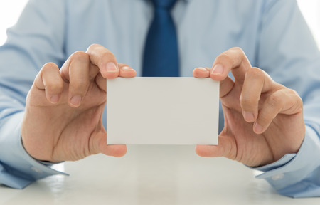 introduce: Sales show a business card to introduce itself to customers. free space for text.
