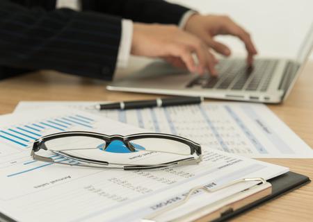 Accountants are preparing a report to present to the executive. Banco de Imagens