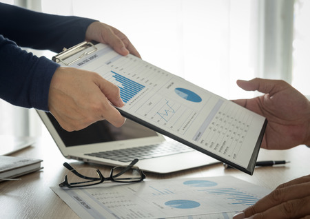 Financial analysts provide summary reports to manager.