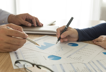 financial performance: manager analyze financial numbers to view the performance of the company. Stock Photo