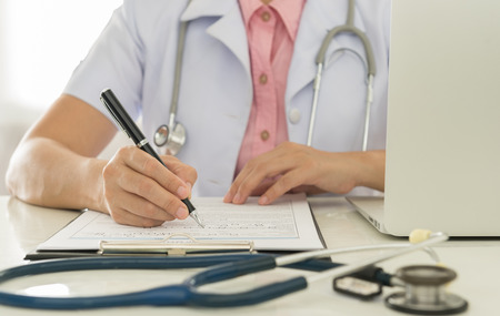 patient data: Doctors are recorded patient data for analysis. Stock Photo