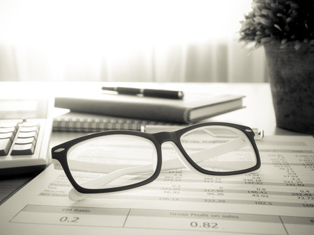 Marketers desk with analysis Report,glasses ,Calculator.selective focus.