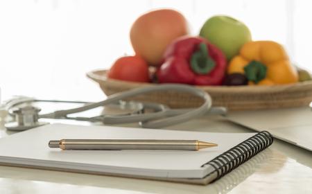 closeup pen on desk's nutritionists in office.