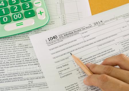 income tax: individual income tax return form on desk Stock Photo