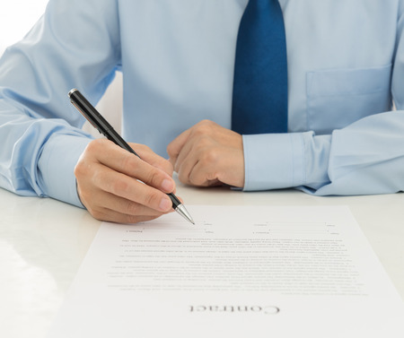 financial insurance: Businessman signing the contract at office