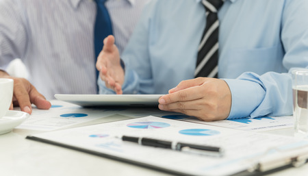 business lifestyle: Accountants are analyzing data from the financial statements of the Company.