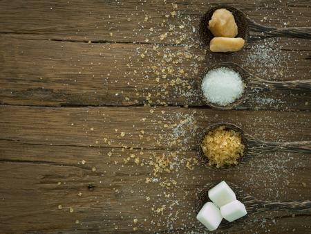 sugar in spoon on wooden background. top view Stock fotó
