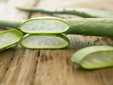 neutralize: aloe vera place the pieces on a wooden table. soft focus Stock Photo