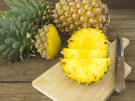 and pineapple juice: pineapple and pineapple slice on wood table. for health. Stock Photo